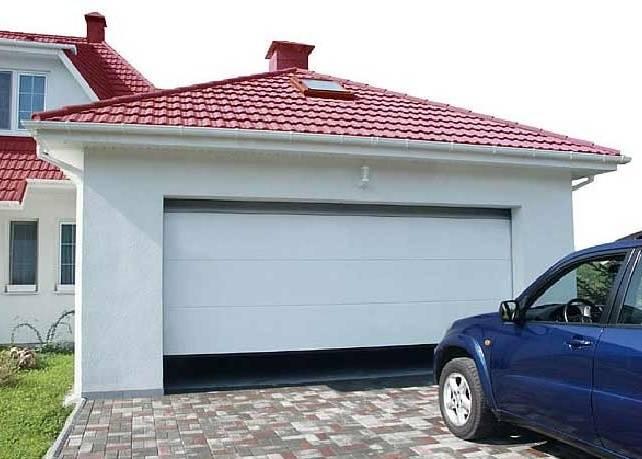Дачный гараж по стилю должен соответствовать основной постройке